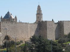 Walls of the Old City of Jerusalem, Israel, with Tower of David and Notre Dame Church. Contact us to arrange your private tour of Israel.