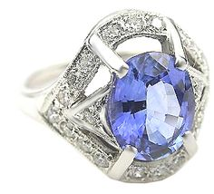 Louis Comfort Tiffany - his favourite combination of platinum and diamonds with a sapphire.