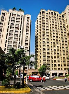 Eastwood City, QC, at around 8 a. Multi Story Building, Architecture, City, Arquitetura, Cities, Architecture Design