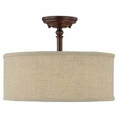 """Semi-flush mount in burnished bronze with a fabric drum shade.       Product: Semi-flush mount   Construction Material: Metal and fabric   Color: Burnished bronze and beige   Accommodates: (3) 60 Watt medium incandescent base bulbs - not included  Dimensions: 11.25"""" H x 15"""" Diameter"""