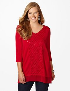 Festive Comfort Tunic: Our shimmering top is comfortable and festive, a great combination for the holiday season. The sequined argyle pattern and sheer asymmetrical hem add interesting flair. Pair this wonderful top with jeans for an inspired casual look. V-neckline. Three-quarter sleeves. #catherines #plussizefashion #holidaystyle #redalert