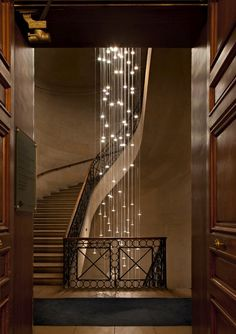 Not sure which is more spectacular...the stairway or the lighting...  Cascading lights within a winding staircase
