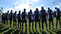 Here the LMU Men's Soccer team lines up for the national anthem before playing a game.