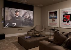 Take movie night out of the living room and into a dedicated den. Comfy sofas, movie prints and a screen to project films onto makes for the perfect space to enjoy a blockbuster. Movie Prints, Comfy Sofa, Saint James, Neutral Tones, New Room, Luxury Living, Contemporary Style, Natural Light, Modern Architecture