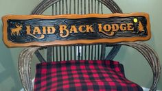 custom carved cedar sign by adirondack jim www.adirondackjims.com