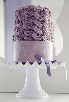 All purple wedding cake with icing flowers