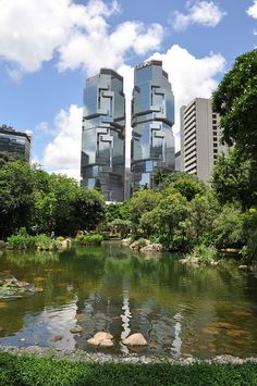 Hong Kong Park and in the background former aussie millionnaire Bond's twin towers full 3D digital design first attempt