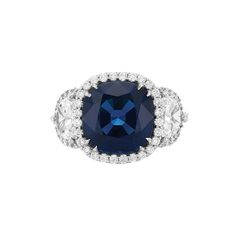 Incredible Platinum, Sapphire and Diamond Ring. One cushion-shaped sapphire approx. 6.25 ct.'s., 2 half-moon shaped diamonds approx. 1.10 ct.'s., round diamonds approx. .55 ct..