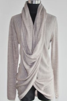 Looks so comfy!This convertible draped neck cardigan sweater features a long shawl collar. Converts into draped neck top with collar twists at front and buttons behind neck. Throw this selection over simple tees and tanks, even body conscious dresses to carry you from day to night. Rolled edge at placket. Long sleeves.