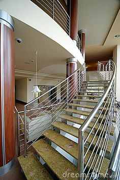 Modern hotel interior, stairs leading upstairs form the lounge room.