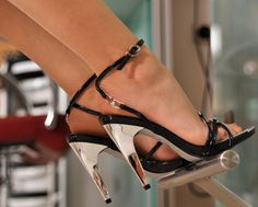 Pretty strappy sandals with silver heels.