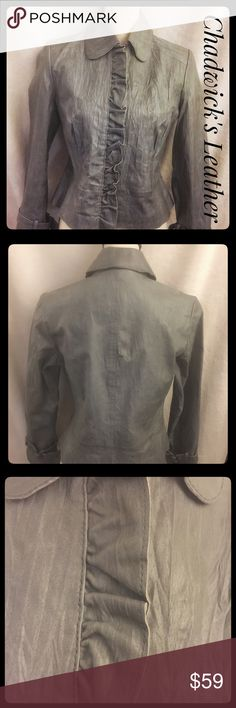 NWOT Chadwick's Leather Jacket Sassy Details sz 8 Amazingly fabulous leather jacket by Chadwick's! It is a soft gray, beautifully detailed with a unique wrinkled leather effect. The front ruffles are a rough edge, adding to the beautiful design. Embellishments on the wrist add to the fashion sass. This is beautiful, never worn, and ready to wear. Gorgeous piece for an extremely great price. Enjoy this unique fashion must have! Chadwicks Jackets & Coats