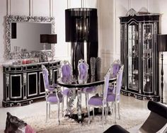 Cool and elegant dining room design ideas: classic dining room with black table cool purple chairs comfortable rug also hanging lamps glass door cabinets floor lamp storage unit and rectangle mirror in artistic frame hung on wall Classic Dining Room Furniture, Retro Dining Rooms, Elegant Dining Room, Luxury Dining Room, Dining Room Design, Dining Room Chairs, Dining Tables, Dining Set, Italian Furniture