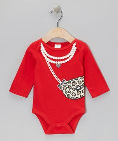 From the playful prints and darling details, this bodysuit is packed with pure precious appeal. A lap neck paired with bottom snap closures makes this piece as easy as pie to pop on/off.100% cottonMachine wash; tumble dryImported