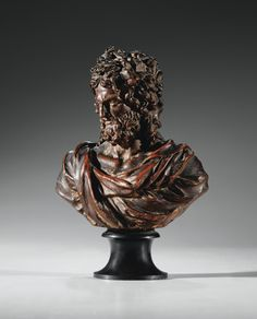 A RARE FRENCH LATE 17TH /EARLY 18TH CENTURY BRONZE PATINATED TERRACOTTA BUST OF JANUS ; ON A BLACK MARBLE BASE