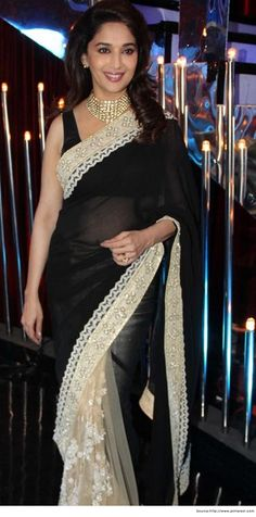 Bollywood Actress Madhuri Dixit in Saree  her looks just hides her age....