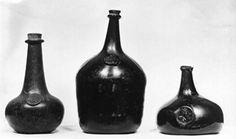 Wine-bottle; glass; green; globular body with tall, rimmed neck; bottle seal inscribed.