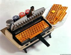 This waffle maker makes waffles in the shapes of keyboards.  Would that make them taste any better?  Probably not.  But the idea is to target those computer techys and technology nerds to buy this unique kitchen appliance.