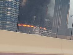 Building near Dubai Mall catches fire  Dubai: Four workers were rescued from a fire that broke out in an under-construction tower near Burj Khalifa around 5.30am on Sunday.