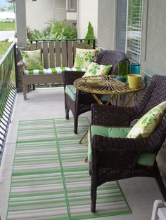 Front Porch 016 they put 6 small rugs together to form a large one - cheaper and they can be reconfigured if need be - great idea!!