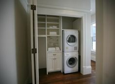 Hidden laundry closet with stackable front loading washer and dryer and built-in storage drawers and shelves with beadboard paneling. Washer Dryer Closet, Laundry Closet, Laundry Room Organization, Laundry Storage, Laundry Room Design, Laundry In Bathroom, Closet Storage, Laundry Area, Closet Shelving