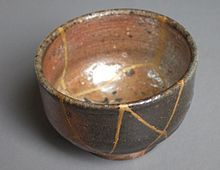 "Kintsugi - Kintsugi (金継ぎ?, きんつぎ, ""golden joinery""), also known as Kintsukuroi (金繕い?, きんつくろい, ""golden repair""), is the Japanese art of repairing broken pottery with lacquer dusted or mixed with powdered gold, silver, or platinum, a method similar to the maki-e technique. As a philosophy, it treats breakage and repair as part of the history of an object, rather than something to disguise."