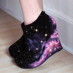 KustomKix space wedges. About $269. I don't think I would ever wear these, but they are pretty cool looking :)