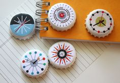 bottle caps painted white then clock [template] cut out and glued on, modge-podge. Add disc shaped magnet (filler to get magnet height equal to bottlecap height.  What other designs would work here? Alphabet magnes for beginning readers.    DIY mid century clock magnets | How About Orange