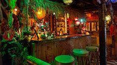 The Tiki Bar is a themed watering hole famous for powerful, exotic cocktails (Mai Tais, Zombies). The classic Tiki Bar often boasts bamboo structures with thatch roofs, Tiki God carvings, tropical. Patio Bar, Backyard Bar, Tiki Bar Decor, Bar Cart Decor, Bar Interior, Interior Design, Bares Tiki, Bar Mexicano, Style Tropical