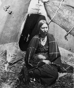 A Dakota woman held captive at the Fort Snelling concentration camp during the winter of 1862-63. The tragic events of that time led to several decades of conflict between Dakota peoples and the U.S. government, during which time the experience and vision of Tail Feather Woman took place. This photograph is in the collections of the Minnesota Historical Society, which has many photographs of Dakota people taken at the Fort Snelling concentration camp.