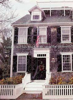 Home exterior ~ Gray clapboard, black shutters with white trim and snow!
