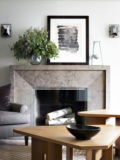 Masculine living space with a Gotham-inspired fireplace and an indoor plant