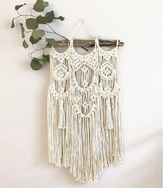 24 of natural organic cotton cord hangs from a beautiful 13 authentic driftwood from Sullivans island. Add this dreamy wall hanging to your bohemian home. Other sizes available upon request. Note that each piece is made specially so design may vary slightly.