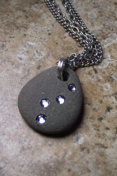 It looks like a river pebble with diamonds imbedded in its surface that give the impression of being drops of clear water.  What a pendant.
