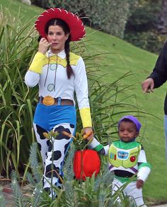 "Sandra Bullock Trick or Treating dressed as Jessie from Toy Story with son ""Buzz."""