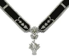 """A CARTIER Belle Epoque diamond and velvet necklace - This is a diamond and platinum choker necklace set in black velvet. It is one of the symbols of Belle Epoque jewellery from the 1900's. During that time, the finest jewellery was mostly white, using diamonds and pearls only. Coloured stones or yellow gold was not considered elegant by society. The most popular style was the """"Garland Style"""" characterised by its delicate designs featuring laurel leaves, ribbon bows or lace patterns."""
