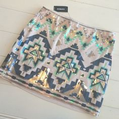 Express Aztec sequin skirt NWT! NWT Express Aztec sequin skirt. Will consider offers Express Skirts Mini