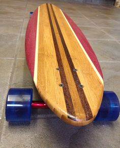 "Custom Bamboo longboard with Wenge inlay and Purple Heart rails. 46"" long pin tail with Paris trucks, 76mm wheels."