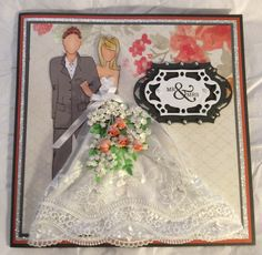 Wedding card for a co-worker.  Julie Nutting prima dolls stamp - Marisol & Adam. Spellbinders decorative label 28. Handmade flowers. My minds eye Bloom paper.