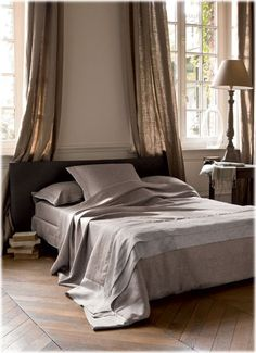 ALT_ elegant-bed-room-long-windows-curtain-panels-gray-decor-wood-floors-eclectic-home-decor-ideas-descamps