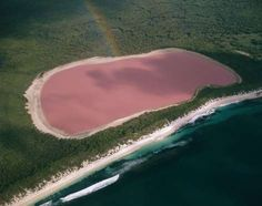 Lake Hillier, Australia  Noted for its unique bubblegum-pink color, Lake Hiller is located in Middle Island, off the coast of western Australia. Some researchers believe that the color is obtained from a micro algae that inhabits the lake. Interestingly, the lake is safe to swim in.