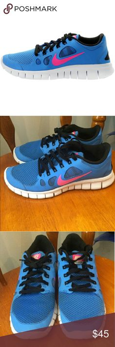 Nike Sneakers Nike sneakers in blue, pink and black. Very comfortable, and in great condition! **These are a size 7Y but fit like a size 8 womens Nike Shoes Sneakers