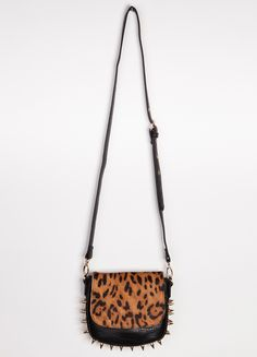 "Leopard & leather: A girl's two favorite things. Don't forget about the gold studs at the side and bottom to give it that everday edge you need. Adjustable strap, snap button closure.    Width 9""  Height 8"""