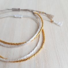cc52eab5c78c Ivory white and gold bracelet packs a brilliant puch