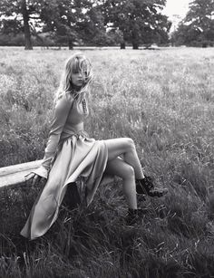 Posing outdoors, Haley Bennett wears dress and boots for Dior Magazine November 2016 Issue