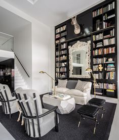 Black and white decor with wall of books