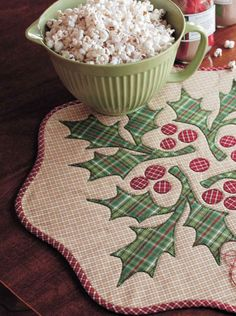 I like the plaid leaves and berries! Homespun Holly Table Topper - Fons & Porter  Digital Pattern