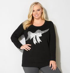 Get a trendy applique look with the sequin-embellished plus size Sequin Bow French Terry Sweatshirt available in sizes 14-32 online at avenue.com. Avenue Store