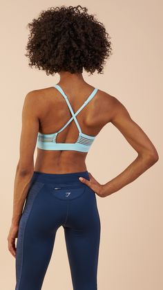 Open cross back design enhances breathability, whilst elasticated feature waistband offers a non-slip feel. Soft stretch fabric guarantees liberated movements and lasting comfort. Complete with printed Gymshark logo. Coming soon in Pale Turquoise.