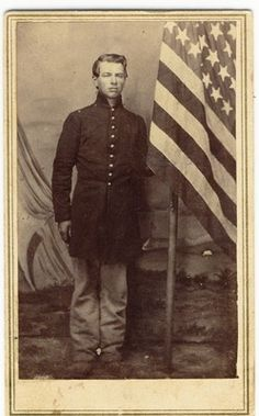 Union Soldier in uniform and an American flag CDV